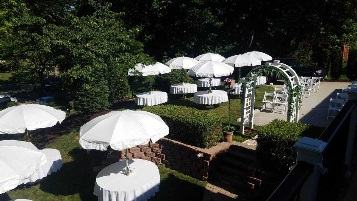 White Arch With Umbrella Tables (Greenery Not Included)