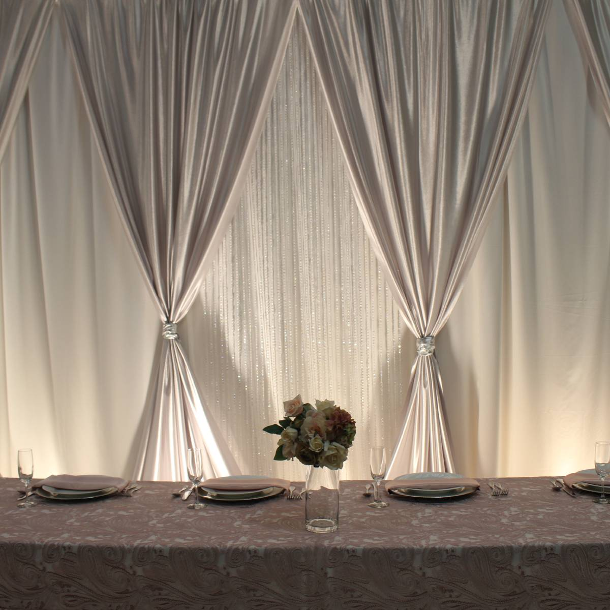 Premier White Backdrop With Polyknit Silver Front Layer V Tied With Jewel Crystal Iridescent Beaded Curtains And Uplights