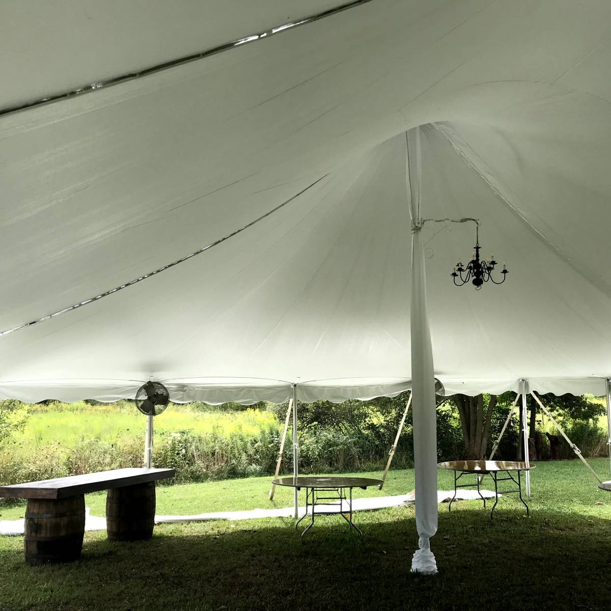 Black Wrought Iron Chandelier In 30x45 Pole Tent With White Center Pole Covers