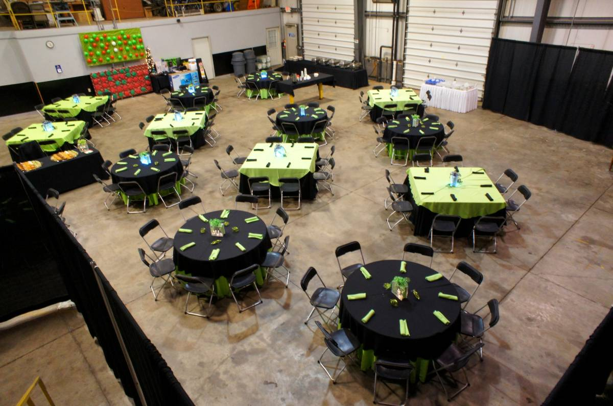 "Table 60x60 Wood Topped With 120x120 Black Solid Tablecover And 90"" Round Lime Solid Toper"