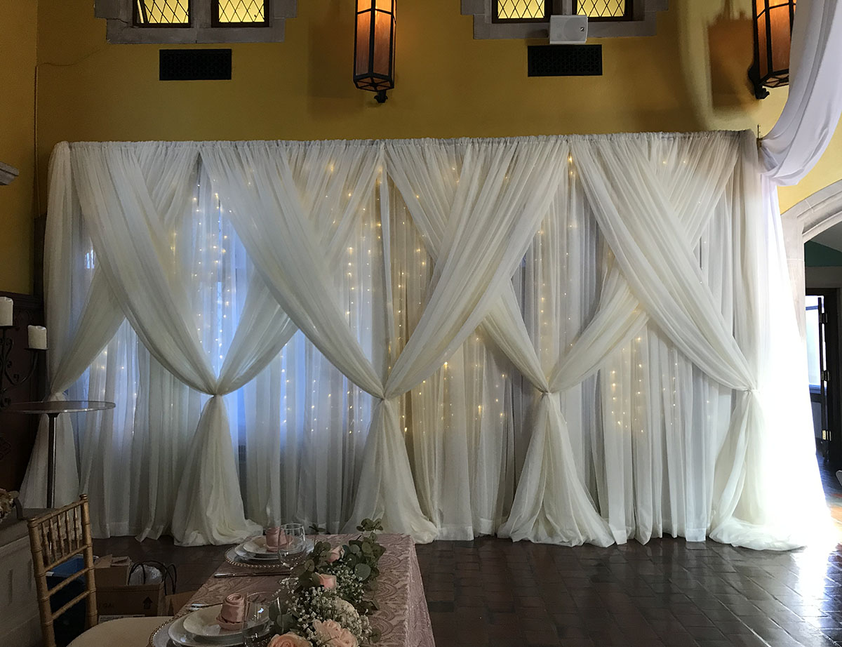 Sheer White Backdrop 20'W x 10'T With Sheer White Front Layer Crisscrossed With Mini Lights
