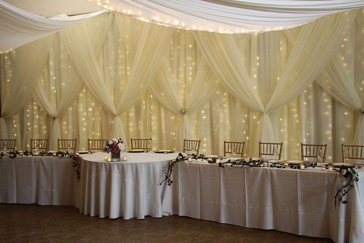 Sheer Ivory Backdrop With Sheer Ivory Front Layer Crisscross Tied With Mini Lights