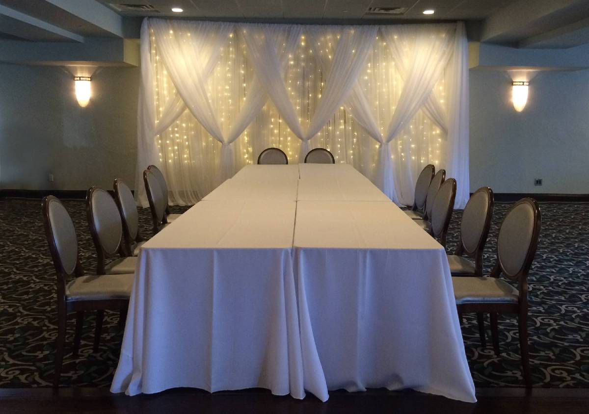 Sheer White Backdrop With Sheer White Front Layer Crisscrossed Tied With Mini Lights