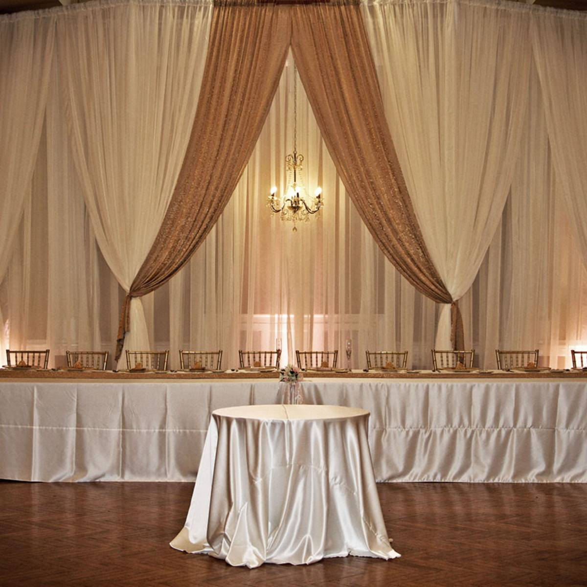 Custom Backdrop Sheer Ivory With Sheer Ivory And Iridescent Crush Front Layer And Crystal Chandelier