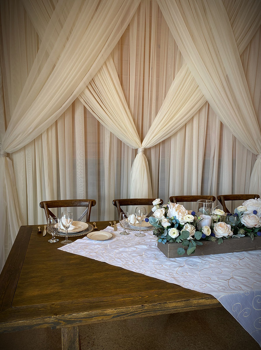 Sheer Ivory Backdrop With Sheer Ivory Front Layer Crisscrossed