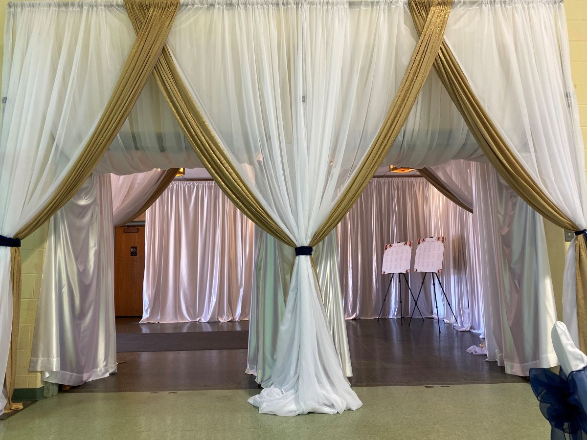 Custom Entrance With Sheer White Backdrop With Accent Iridescent Crush Camel Drape