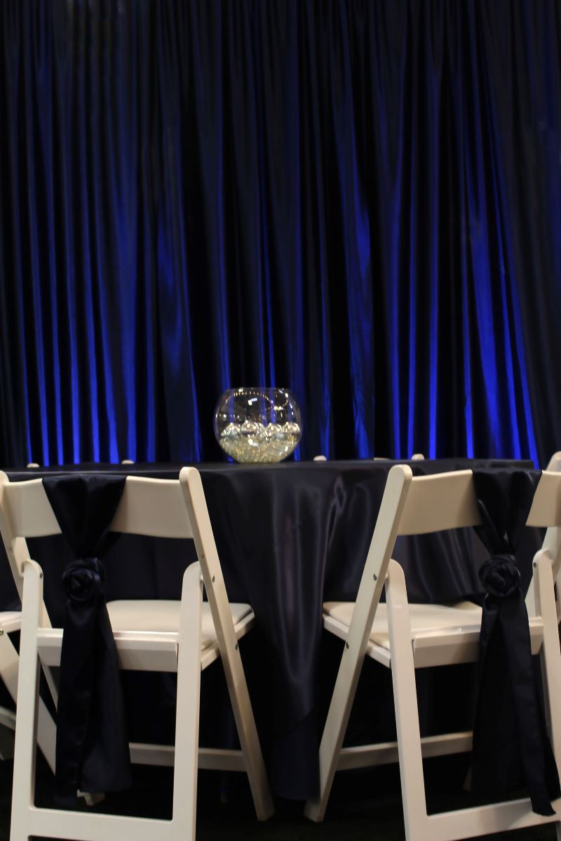Navy Poly Satin Tablecover, Navy Poly Satin Sashes, Navy Polyknit Backdrop With Uplights